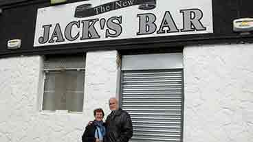 Outside Jack's Bar Marie and her husband standing outside