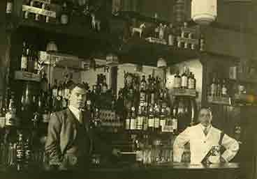 One of the owners James Omand on the left with head barman on the right 1938