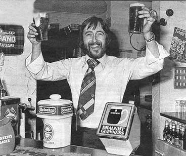 Image of Dougie Henderson behind the bar 1978.