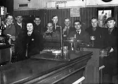 Mrs Margaret Clelland behind the bar at the end of the war