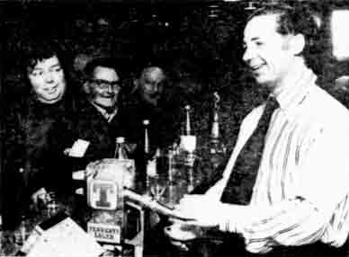 Peter Keenan pulling a pint in his bar. 1976
