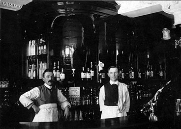 Interior image of M Fearon with Michael Fearon on the left with head barman on the right.